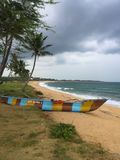 Fisherman boat piroga on the Indian ocean shore. Hambantota, Sri Lanka royalty free stock image