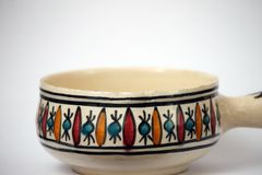 Traditional handcrafted, colorful decorated ceramic bowl stock photo