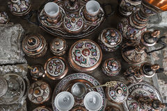 Traditional handcrafted copper coffee pots in souvenir shops in Royalty Free Stock Photo