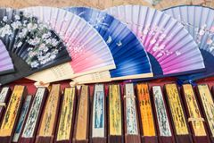 Traditional handicraft chinese fans at market in Yangshuo, China.  royalty free stock photo