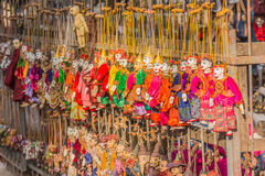 Traditional handicraft puppets are sold in a shop in Bagan, Myan Stock Images