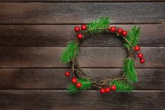 Free Traditional Handmade Christmas Wreath Green Fir Tree Branches Twigs Holly Berries On Dark Plank Wood Background. Top View Stock Photos - 102294653