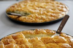 Traditional  handmade Pies. Two pies with spinach and cheese Royalty Free Stock Photos