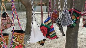 Traditional handmade textile bag colorful. Colorful traditional handmade textile bag romanian  hanging in the wind stock video footage