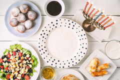 Traditional Hanukkah  dishes on the white wooden table  horizontal Stock Photo