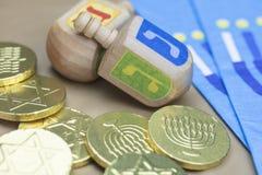 Hanukkah Dreidels, Napkins and Chocolate Gelt Coins. Traditional Hanukkah Dreidels, Napkins and Chocolate Gelt Coins Royalty Free Stock Image