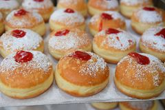 Traditional hanukkah sufganiyot with strawberry jelly Stock Photography