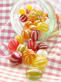 Traditional hard boiled sweets in jar Stock Images
