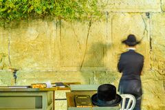 Traditional hat and a Jewish prayer in the Western Wall. JERUSALEM, ISRAEL - SEPTEMBER 06, 2017: Traditional hat and a Jewish prayer in the Western Wall Royalty Free Stock Photos