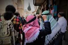 Traditional hats and kaffiyah in the old city of jerusalem israel. Traditional hats and kaffiyah are seen in the old city of jerusalem all year round Royalty Free Stock Photo