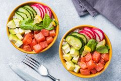 Traditional Hawaiian Poke salad with salmon, avocado rice and vegetables in a bowl on two persons. Top view.  royalty free stock images