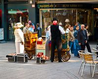 Traditional hawker in the bustling commercial street of Cologne Stock Images