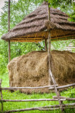 Traditional hay stacks, typical rural scene Royalty Free Stock Photo