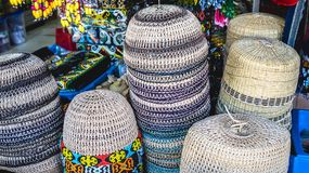 Traditional head wear / hat made from rattan. Displayed in front on souvenir shop in Samarinda, Indonesia Royalty Free Stock Image