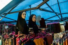 The traditional headgear of Muslim women in the market. Malaysia. The traditional headgear of Muslim women in the market. Borneo, Malaysia Stock Photo