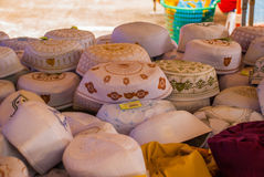 The traditional headgear of the Muslims men in the market. Malaysia Royalty Free Stock Image