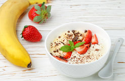 Traditional healthy Breakfast. Natural yogurt with strawberries, banana and chocolate Royalty Free Stock Photo