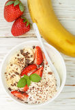 Traditional healthy Breakfast. Natural yogurt with strawberries, banana and chocolate Royalty Free Stock Photos