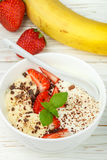 Traditional healthy Breakfast. Natural yogurt with strawberries, banana and chocolate Royalty Free Stock Images