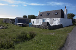 Traditional Hebridean Black House. View of traditional Hebridean Black house set in the machair on the island of Tiree in the Scottish isles Royalty Free Stock Photography