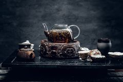 Traditional herbal tea in transparent glass teapot. Studio shot. Traditional herbal tea in transparent glass teapot Royalty Free Stock Image