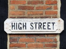 Traditional High Street sign attached to brick wall with timber beams stock photo