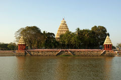 Traditional Hindu temple on lake in the city center, South India Stock Photo