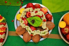 Traditional Hindu wedding ceremony, coconuts and fruits with betel leaf, flowers royalty free stock photo
