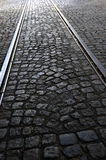 Traditional and historic cobblestone way with rails Royalty Free Stock Images