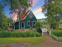 Traditional historical old dutch wooden house in the countryide royalty free stock images