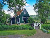Traditional historical old dutch wooden house in the Netherlands royalty free stock photo