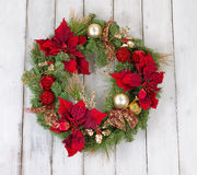 Traditional holiday Christmas wreath on rustic white wooden boar Stock Photography