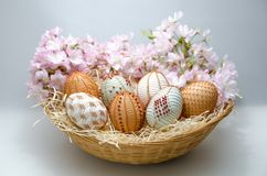 Traditional holiday - Easter. Eggs in a basket. Wireworking. stock photos
