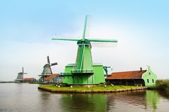 Traditional Holland windmills in Zaanse Schans village Royalty Free Stock Images