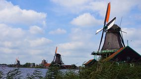 Traditional Holland Windmills in Zaanse Schans, Netherlands. Touristic Village near the Amsterdam with the windmills and