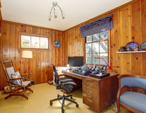 Traditional home office with wood panel walls. Royalty Free Stock Photos