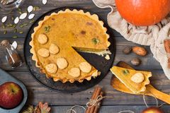 Traditional homemade American pumpkin pie with a decor of a cookie in the form of leaves for a holiday stock photos
