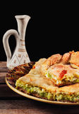 Traditional homemade balkan leek and cheese pie Zelnik served with rakija Royalty Free Stock Images