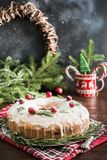 Traditional homemade Christmas cake with garnish cranberry and rosemary on decorative plate stock image
