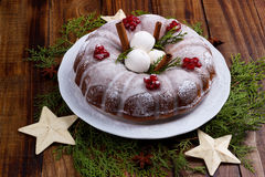 Traditional homemade christmas cake. On vintage wooden background. Top view Stock Photos