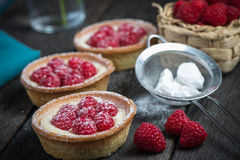 Traditional homemade fresh raspberry tart. On wooden table Royalty Free Stock Photo