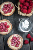 Traditional homemade fresh raspberry tart. On wooden table Royalty Free Stock Images