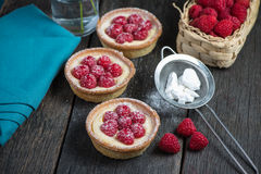 Traditional homemade fresh raspberry tart. On wooden table Stock Photography
