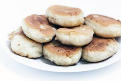 Traditional homemade fried patties or pies made of yeast dough in a rustic style on white plate stock photo