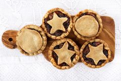 Traditional homemade fruit mince pies on a cutting board royalty free stock images