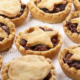 Traditional homemade fruit mince pies on white stock image
