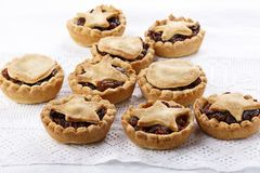 Traditional homemade fruit mince pies on white royalty free stock photos