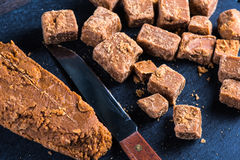 Traditional homemade fudge toffee, cut in squares cubes Stock Photos