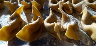 Traditional homemade Italian dumplings Casoncelli from Bergamo - Italian fresh pasta closeup royalty free stock photography