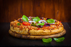 Traditional homemade pizza with tomatoes and olives stock photos